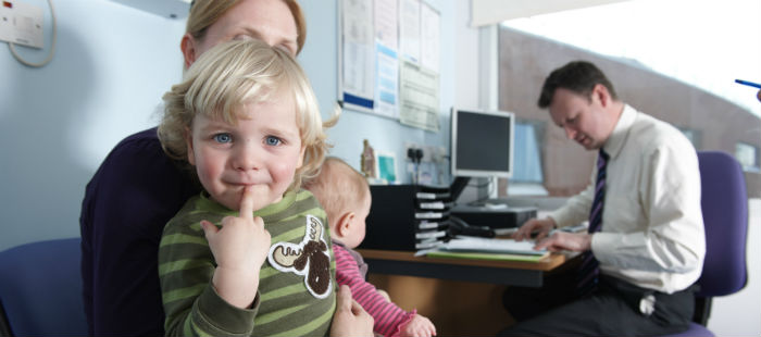 Mother and small child with doctor
