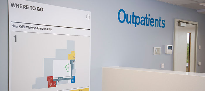 Photo of the main outpaitents reception desk and map