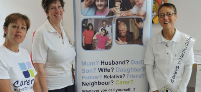 Volunteers from Carers in Herts holding information session at the New QEII